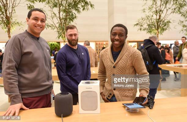 Customers pose with The Apple HomePod which is now available in stores in the US UK and Australia at Apple Store on Regent Street on February 9 2018...