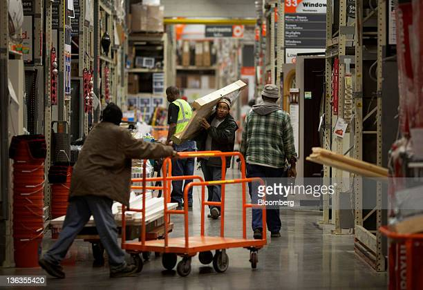 Customers purchase building materials at a Home Depot Inc store in the Brooklyn borough of New York US on Friday Dec 30 2011The US Census Bureau is...