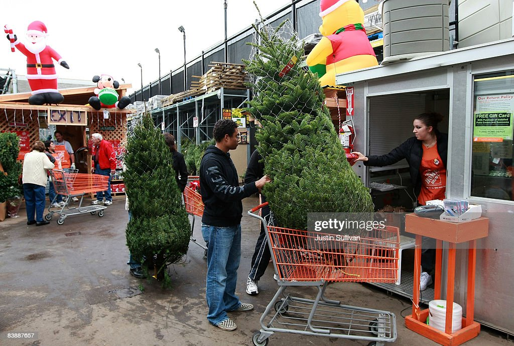 Customers Purchase Christmas Trees At A Home Depot Store