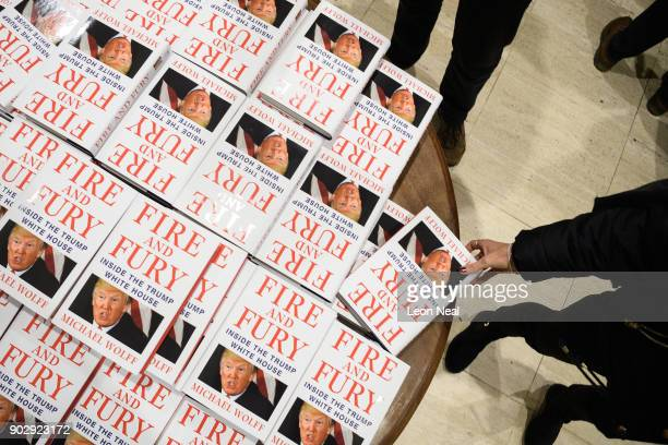 Customers purchase copies of one of the first UK consignments of 'Fire and Fury' Michael Wolff's book on President Trump's Presidency at Waterstones...