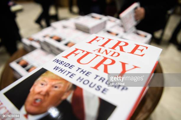 Customers purchase copies of one of the first UK consignments of Michael Wolff's book on President Trump's Presidency 'Fire and Fury' at Waterstones...