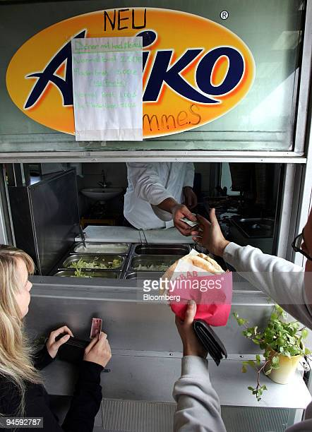 Customers purchase doener kebabs at Kuecuek Coekelekci's kebab stand on the GermanSwiss border in Jestetten Germany on Thursday Oct 11 2007 The...