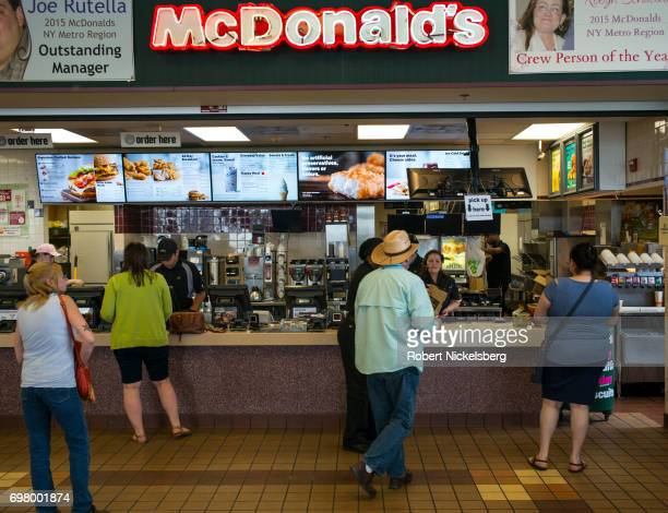 Customers purchase food at a McDonald's restaurant June 1, 2017 along the New York State Thruway in Plattekill, New York. McDonald's is the workld's...