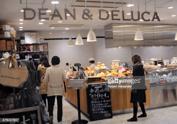 Customers purchase food items at a Dean Deluca gourmet food shop in Tokyo's trendy Shibuya district