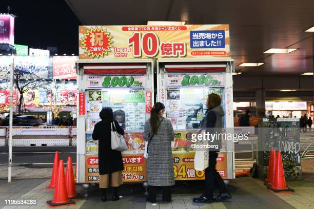 Customers purchase lottery tickets in the Shibuya district in Tokyo, Japan, on Monday, Jan. 20, 2020. Japans key measure of inflation rose at the...