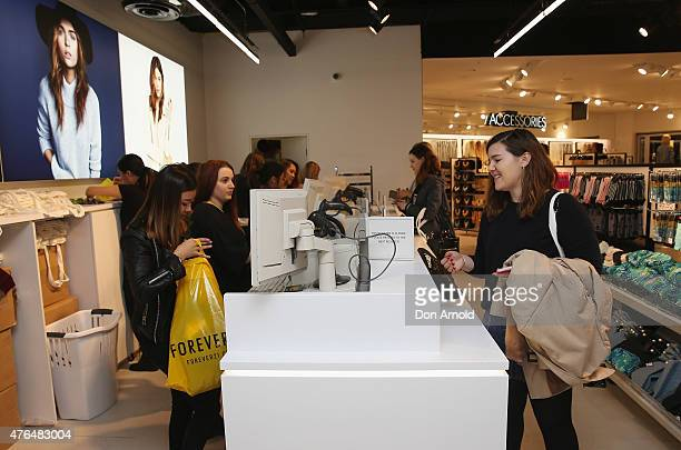 Customers purchase merchandise at the opening of the 'FOREVER 21' flagship store on Pitt Street on June 10, 2015 in Sydney, Australia.