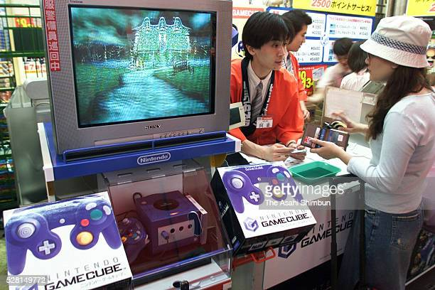Customers purchase Nintendo's new game console 'Gamecube' on September 14 2001 in Tokyo Japan