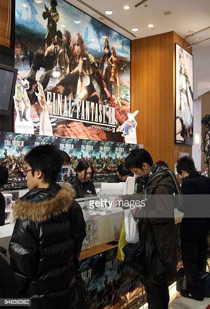 """Customers purchase Square Enix Holdings Co.'s """"Final Fantasy XIII"""" role-playing video game at a launch event in the Sibuya district on December 17,..."""