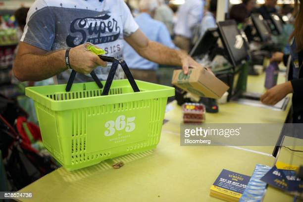 Customers purchases items during the grand opening of a Whole Foods Market 365 location in Santa Monica California US on Wednesday Aug 9 2017 The...