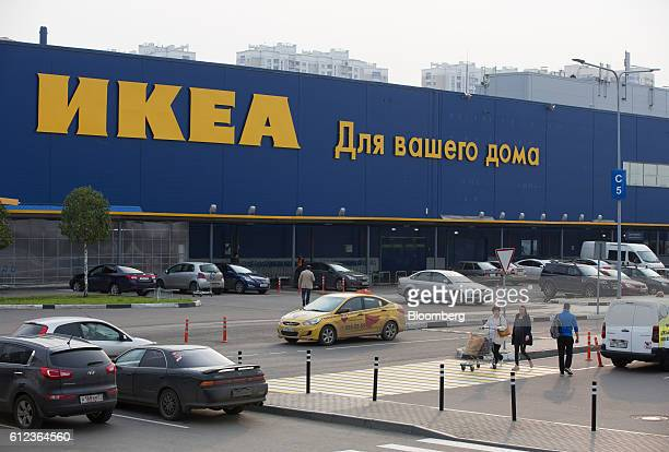 Customers push a shopping cart through the parking lot outside the Ikea AB retail store in Khimki Russia on Monday Oct 3 2016 Ikea's Russia unit may...
