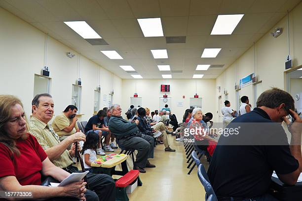 Customers que in DMV waiting room