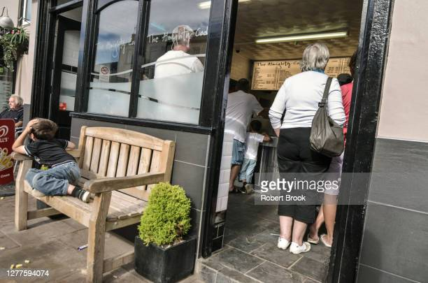 customers queing at fish and chip shop, 'the almighty cod' on the seafront at seaton carew, hartlepool, uk, august 2012 - united_states_house_of_representatives_elections_in_florida,_2012 stock pictures, royalty-free photos & images