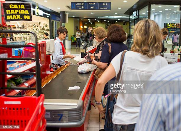Customers queue at a check out desk inside an Eroski supermarket operated by Grupo Eroski a unit of Mondragon Corp in Albacete Spain on Wednesday Oct...