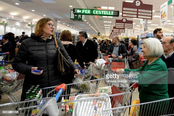 Customers queue at checkouts as Italian supermarket chain Esselunga opens its first store in Rome in Via Palmiro Togliatti on April 5 2017 in Rome...