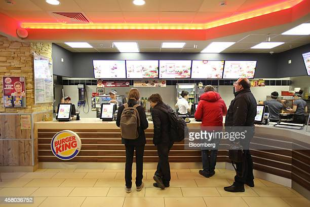 Customers queue at the service counter inside a Burger King fast food restaurant operated by Burger King Worldwide Inc in Moscow Russia on Tuesday...