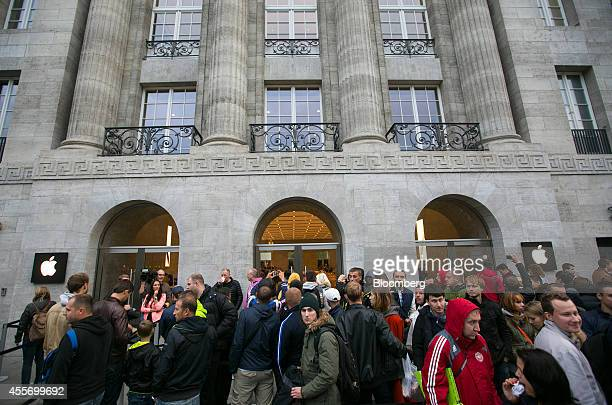 Customers queue before the sales launch of the iPhone 6 and iPhone 6 Plus at the Apple Inc store in Berlin Germany on Friday Sept 19 2014 The devices...