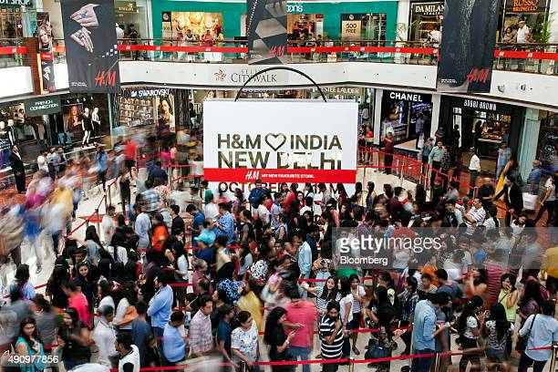 Customers queue for the opening of a Hennes Mauritz AB store in Select Citywalk mall in the Saket area of New Delhi India on Friday Oct 2 2015 The...