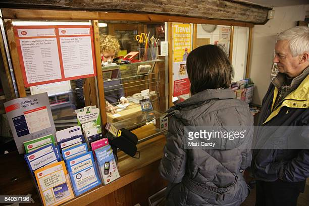 Customers queue inside the historic Lacock Village Stores and Post Office on December 15 2008 in Lacock United Kingdom Post Offices across the UK are...