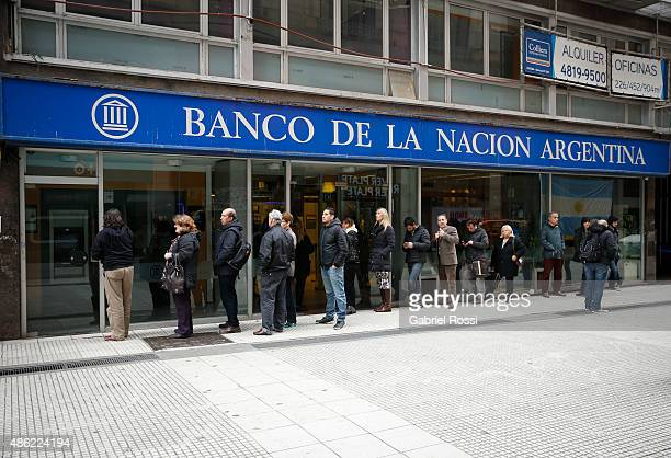 Customers queue outside a Banco de la Nacion Argentina branch on September 01 2015 in Buenos Aires Argentina US Dollar has raised it's quotation 95%...