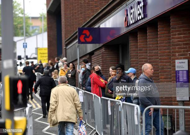 Customers queue outside a NatWest bank on June 15, 2020 in Stoke-on-Trent, United Kingdom. The British government have relaxed coronavirus lockdown...