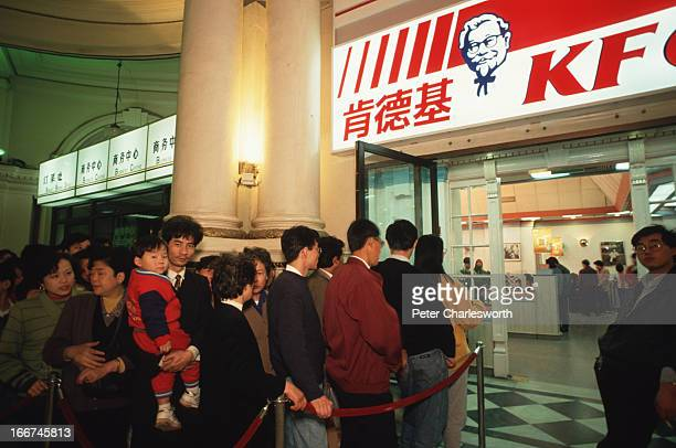Customers queue outside a packed Kentucky Fried Chicken outlet on the Nanjing Road These symbols of Globalization have become hugely popular in China