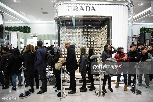 Customers queue outside a Prada stall during the Boxing Day sale at Selfridges on December 26 2016 in London England Boxing Day is traditionally one...