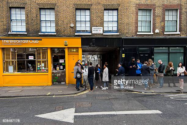 Customers queue outside The Breakfast Club in Soho on March 29 2016 in London England Long established as the West Ends entertainment district with a...