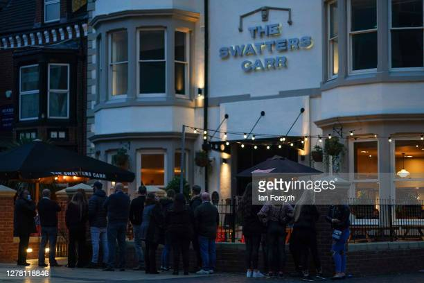 Customers queue to enter a pub on Linthorpe Road in Middlesbrough on October 02, 2020 in Middlesbrough, England. The mayor of Middlesbrough, Andy...