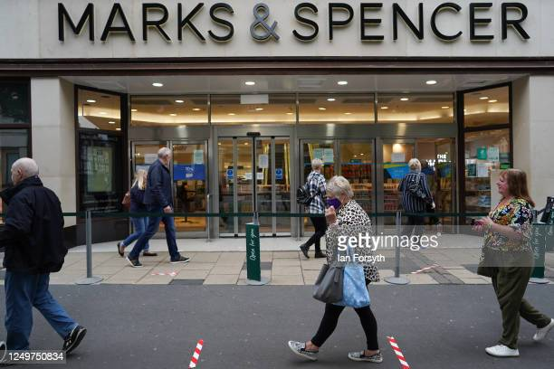 Customers queue to enter Marks and Spencer in York as non-essential stores prepare to reopen on June 15, 2020 in York, United Kingdom. As the British...