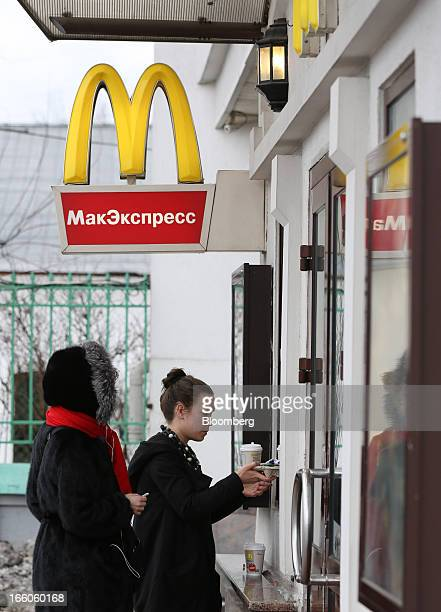 Customers queue to place their orders at a service window outside a McDonald's food restaurant in Moscow Russia on Sunday April 7 2013 McDonald's...