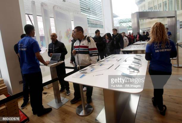 Customers queuing for the Samsung Galaxy S4 smartphone at the Samsung Experience Store at Westfield Stratford City, east London.