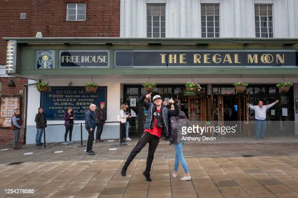 Customers react to the camera at the Regal Moon JD Wetherspoons pub on July 04 2020 in Rochdale England The UK Government announced that Pubs Hotels...