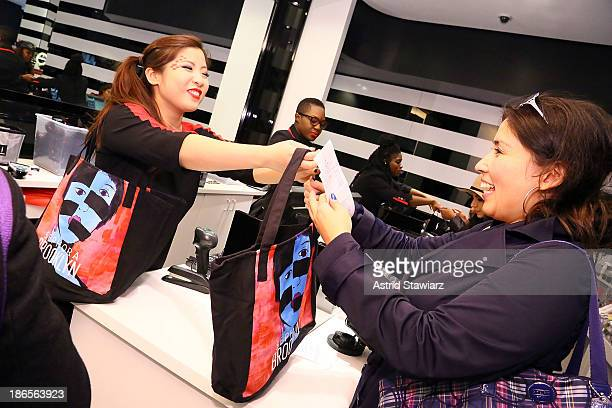 Customers receive a Sephora Brooklyn tote bag featuring artwork by illustrator Gary Panter at Sephora Brooklyn Grand Opening on November 1 2013 in...