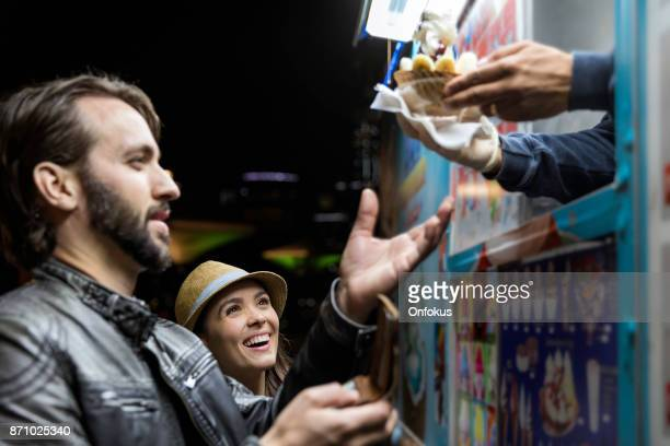 customers receiving ice cream product at the food truck - food truck stock photos and pictures