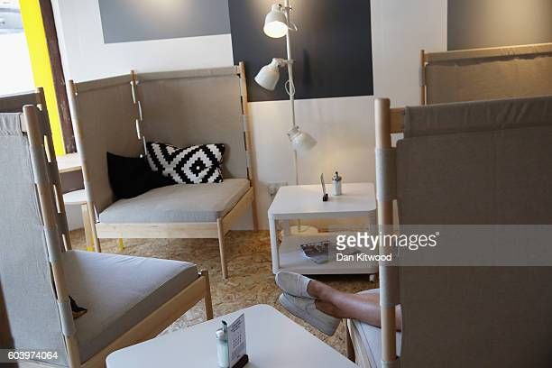 Customers relax inside Ikea's 'The Dining Club' pop up restaurant cafe and shop in Shoreditch on September 13 2016 in London England The Scandinavian...