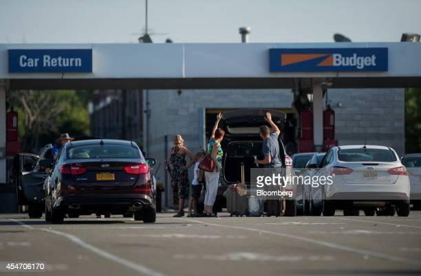 Customers return a rental car to the Avis Budget Group Inc location for LaGuardia Airport in the Queens borough of New York US on Monday Aug 25 2014...