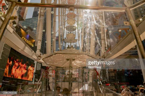 Customers ride on the Times Square Wheel in the Times Square neighborhood of New York, U.S., on Saturday, Sept. 4, 2021. This month, as Broadway...