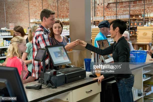 Customers sampling beverage in nutrition store