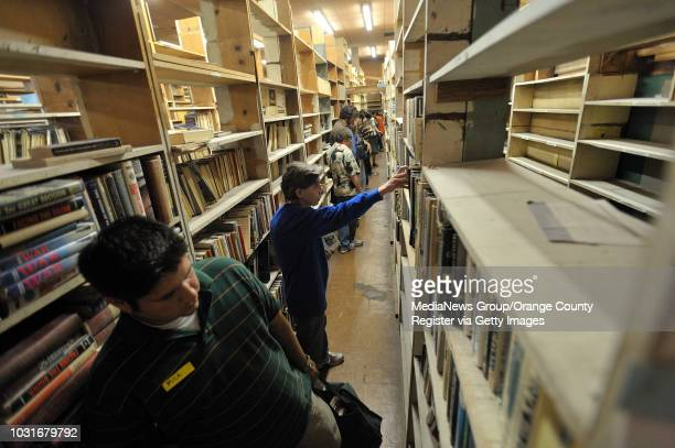 USA Customers search for books during Acres of Books' last hurrah in Long Beach CA on July 10 2010 The ArtExchange who now owns the iconic Long Beach...