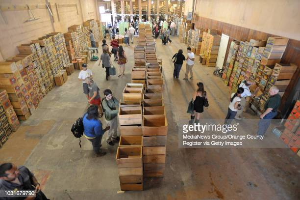 USA Customers search for the perfect fruit crate to cart away their books during Acres of Books' last hurrah in Long Beach CA on July 10 2010 The...