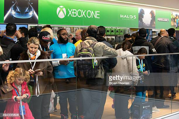 Customers search the Xbox floor of Microsoft's first flagship store on Fifth Avenue on October 26 2015 in New York City Hundreds of eager customers...