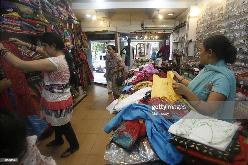 Customers select kurtis at a famous kurti shop at the GK-1 market in New Delhi on April 19, 2010.