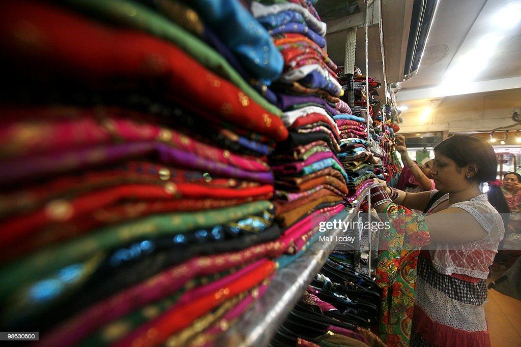 Customers select kurtis at a famous kurti shop at the GK-1 market in New Delhi on April 19, 2010.