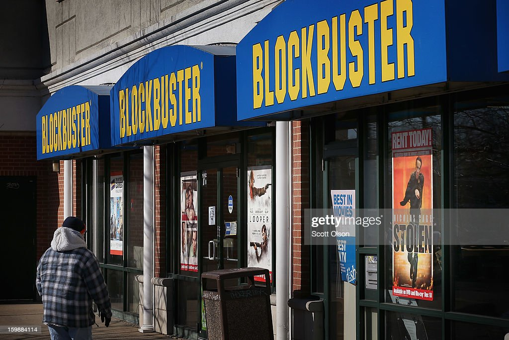 Customers shop at a Blockbuster video store on January 22, 2013 in Chicago, Illinois. Dish Network Corp., which owns the video rental chain, says it plans to close about 300 Blockbuster stores across the country, eliminating about 3,000 jobs.