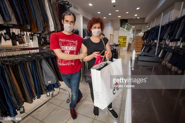 Customers shop at a clothing store on May 23 2020 in Matera Italy Restaurants bars cafes hairdressers and other shops have reopened subject to social...