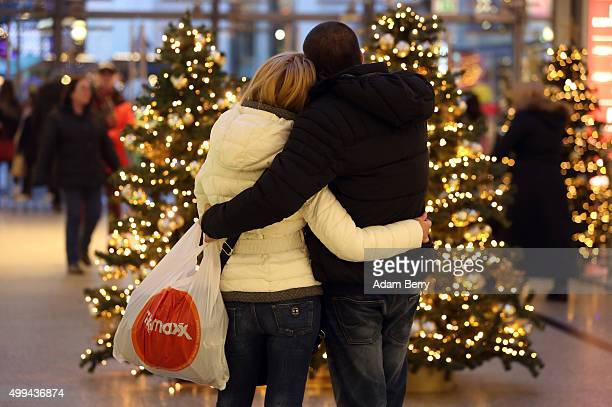 Customers shop at a mall on December 1 2015 in Berlin Germany German consumer morale and willingness to spend showed signs of declining less than...
