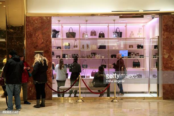 Customers shop at a new Ivanka Trump brand store in the lobby of Trump Tower December 15 2017 in New York City Ivanka Trump's fashion company opened...