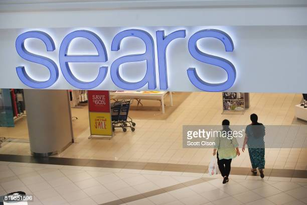 Customers shop at a Sears store in Woodfield Mall on July 20 2017 in Schaumburg Illinois Sears announced today that it had agreed to sell Kenmore...
