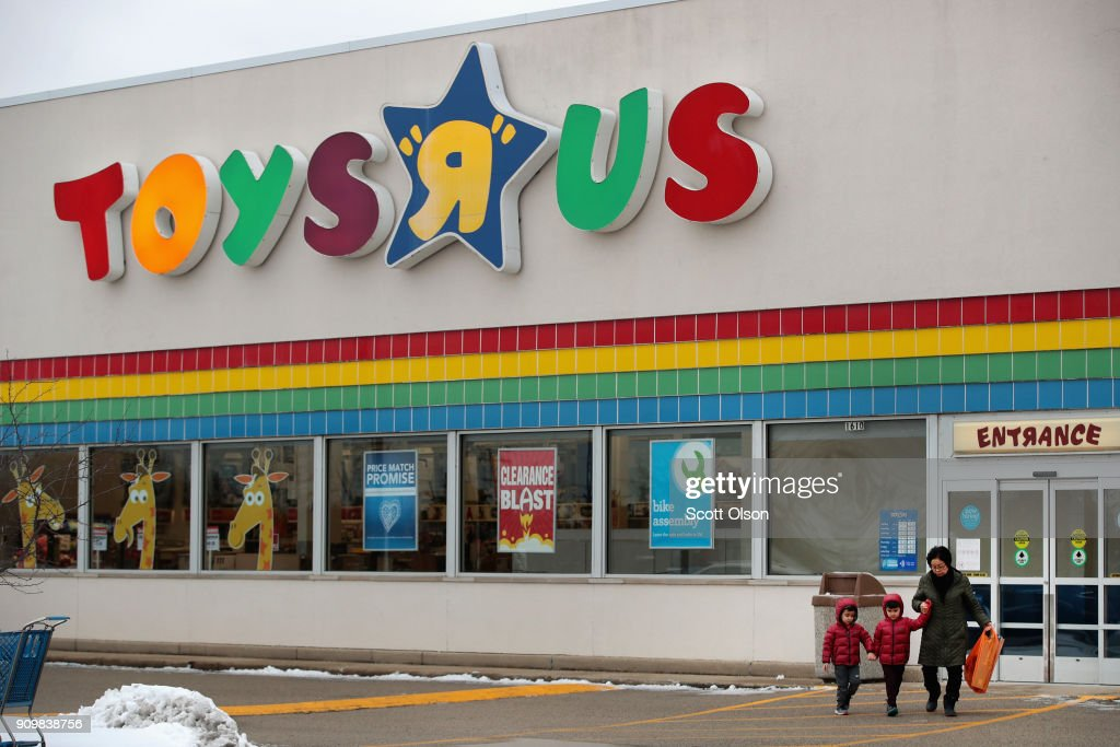 Customers shop at a Toys 'R' Us store on January 24, 2018 in Highland Park, Illinois. The store is one of more than 180 Toys 'R' Us and Babies 'R' Us stores scheduled to close. The closings involve about one-fifth of the company's Toys 'R' Us and Babies 'R' Us U.S. store fleet. The company recently filed for bankruptcy protection.