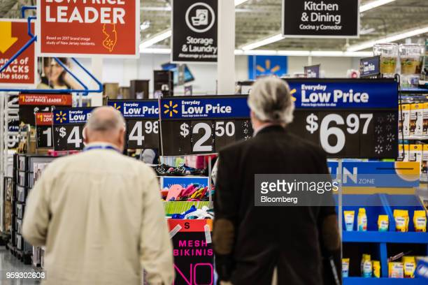 Customers shop at a Walmart Inc store in Secaucus New Jersey US on Wednesday May 16 2018 Walmart is scheduled to release earnings figures on May 17...